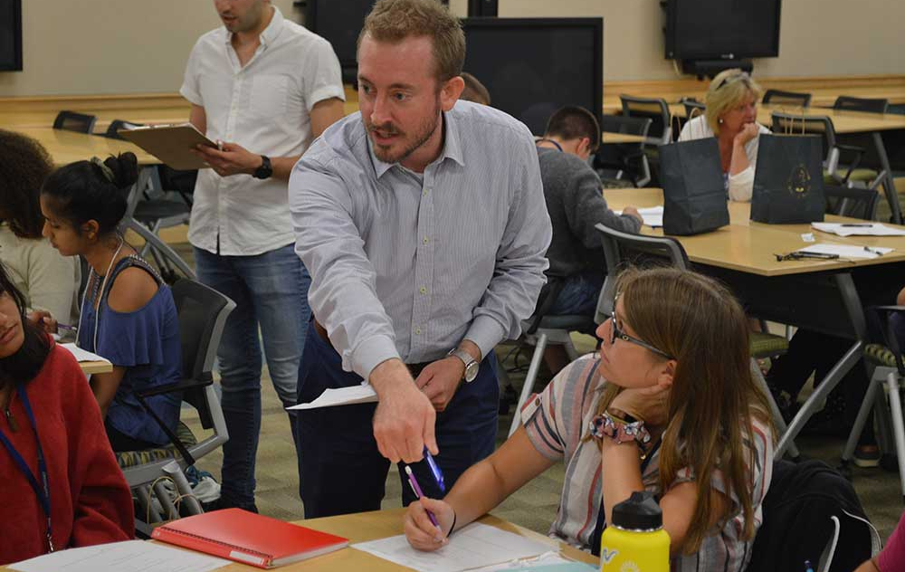 Dr. Berenbrok engaging with students as they learn counseling techniques