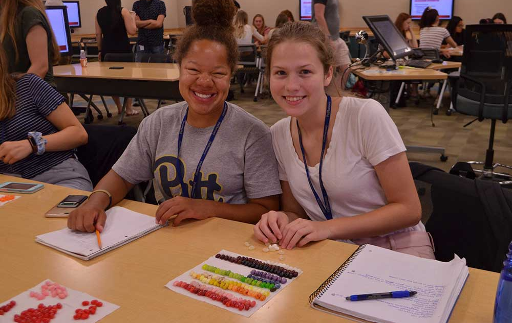 Two RxPlorers having fun as they learn about Managed Care!