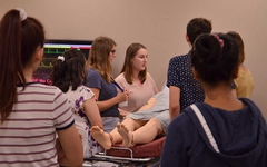 Campers engaging in a patient simulation