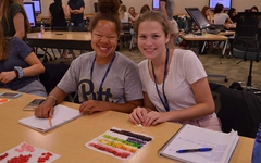 Two campers having fun as they learn about Managed Care!